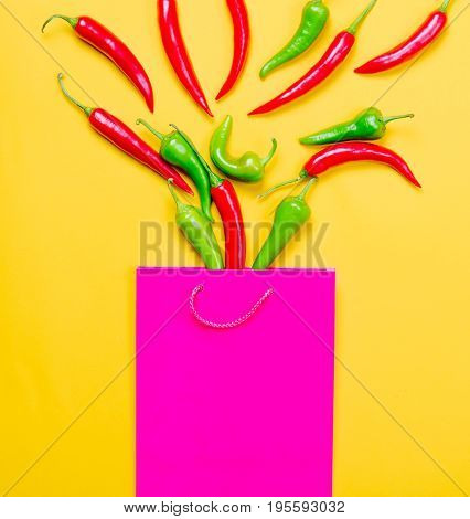 Above View At Chili Pepper And Shopping Bag