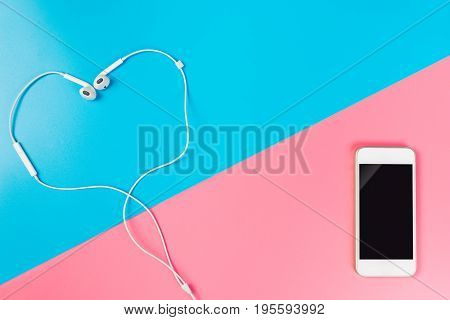 Heart shaped earphone with blank smartphone for Romantic love song concept