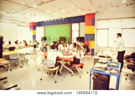 Abstract Blur Image Of People Or Students Lecture In Seminar Room, Facility Morden Workshop. Educati