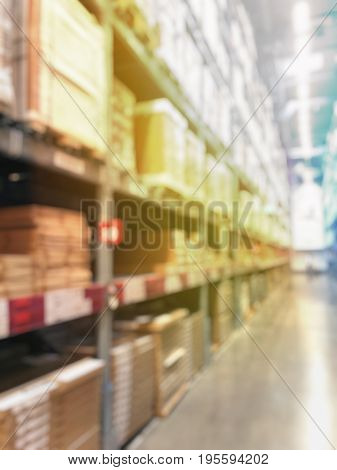 Blurred Warehouse Or Storehouse With The Boxes On High Shelves Stocked. Motion Blur Effect. Bright S