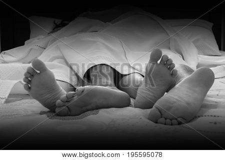 Indoor Shot Young Couple's Legs, Sleep On Bed