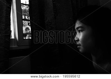 Girl Looking Outside With Absent Minded