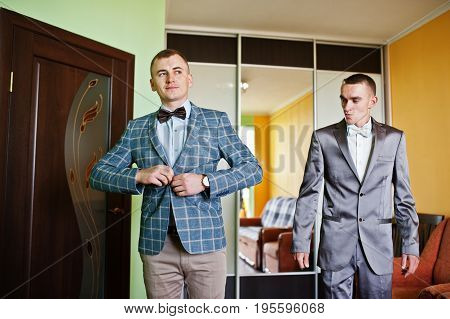Groomsman Helps Groom To Dress Up For His Wedding.