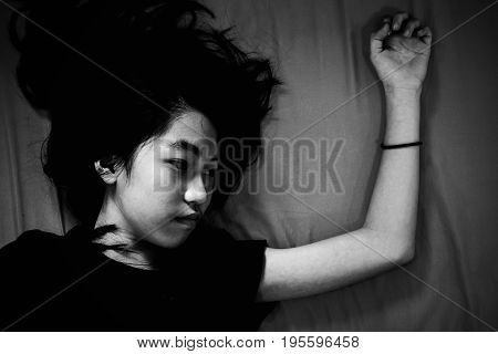 Girl Lay On Bed With Fear