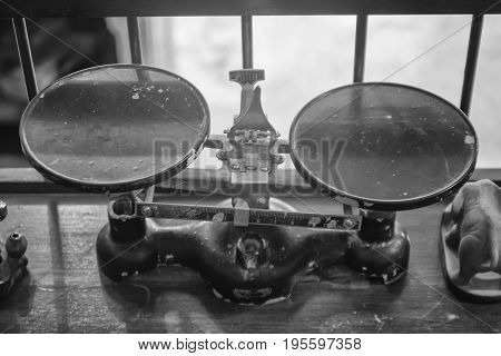 The scales balance weight machine use for weighing of ancient Chinese herbs and brass weight. vintage.