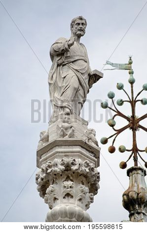 Statue of Saint Mark on the roof of the Doge's Palace in Venice Italy.