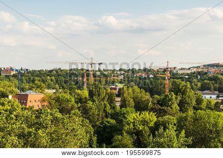 PRAGUE, CZECH REPUBLIC - JUNE 10: Prague skyline with construction cranes. In Prague, Czech Republic. View from the Prague Zoo.