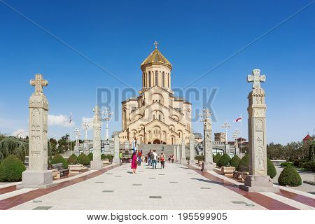 TBILISI GEORGIA - May 1 2017. Tourists near The Holy Trinity Cathedral of Tbilisi (commonly known as Sameba).