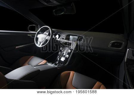 Modern luxury car interior, black dark leather interior