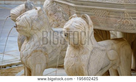 Detail view of the famous Lion Fountain in Alhambra Palace, Granada, Spain.