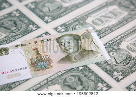 US 1 dollar banknote covered by chinese yuan