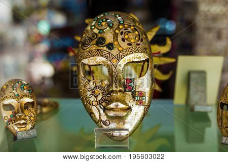 venetian mask in gold design - placed in the stores of Venice