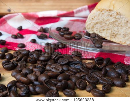 Coffee and bread on wooden background on table