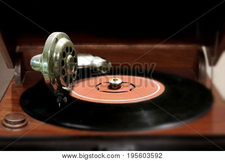 Vintage vinyl record and player with blur background