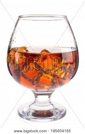 Brandy with ice in goblet, isolated on white background.