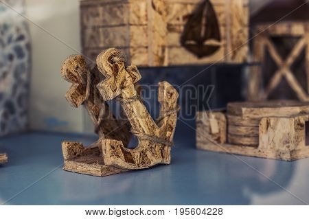 Wooden decorative anchor in the gift shop