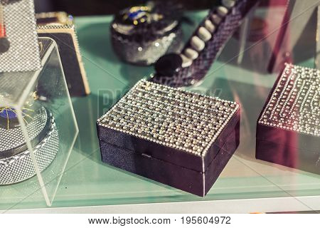Variety of samples of different bright, colorful jewelry boxes in oriental style