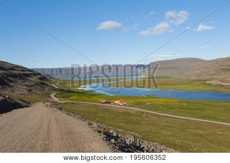 Extremely beautiful bay with mighty fjords mountains and turquise sea in the West Fjords, Iceland. Panoramic photo