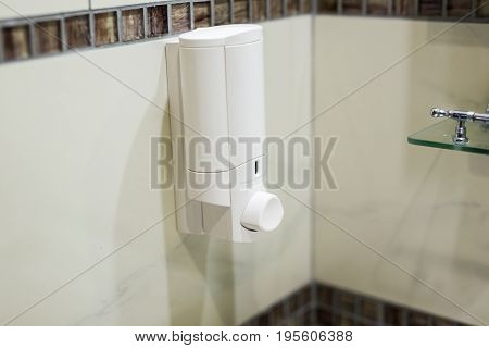 Automatic Soap Dispenser in toilet at hotel or department store, Liquid soap container.