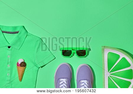 Summer Hipster Girl Accessories Set. Fashion Design. Hot Summer Sunny Vibes. Glamor Lime Citrus Clutch, Trendy Sneakers, fashion Sunglasses on Green. Sweet Style. Pastel Color. Surreal, Minimal, Art