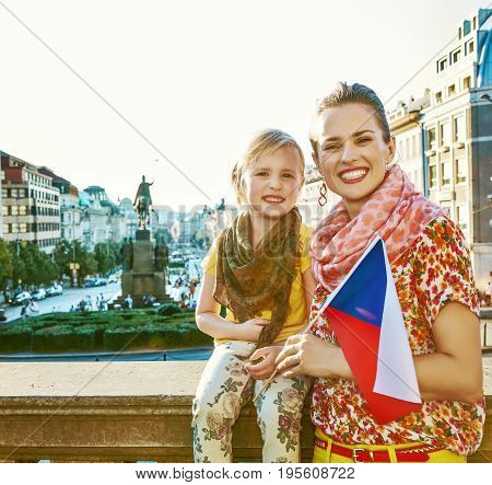 Smiling Mother And Child Tourists With Czech Flag