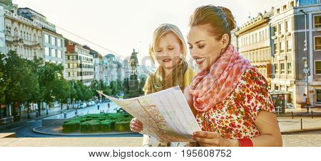 The spirit of old Europe in Prague. smiling young mother and daughter tourists on Vaclavske namesti in Prague Czech Republic looking at the map