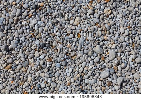 Small pebbles that cover the coastline of Etretat, a commune in the Seine-Maritime department in the Normandy region of north western France