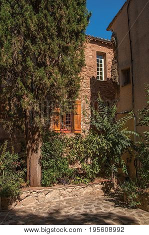 Les Arcs-sur-Argens, France. View of stone houses in a narrow alley, at the gorgeous medieval hamlet of Les Arcs-sur-Argens. In the Provence region, Var department, southeastern France