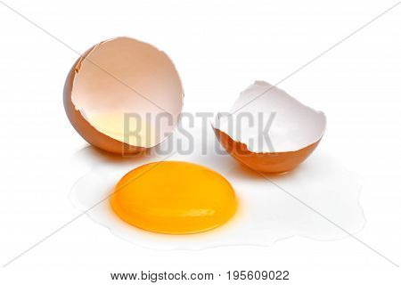 cracked egg with egg shell egg yolk and egg white isolated on white background