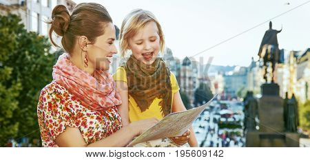 The spirit of old Europe in Prague. happy young mother and child travellers on Vaclavske namesti in Prague Czech Republic looking at the map