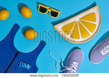 Fashion Summer Hipster Accessories Set. Lemon Citrus fruit, Trendy Sneakers, Clutch, fashion Sunglasses on Blue. Hot Summer Sunny Vibes. Creative Bright Style. Vanilla Pastel Color. Minimal, Art