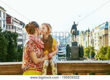 Smiling Mother And Daughter Tourists In Prague Kissing