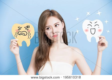 woman take health and decay tooth billboard on the blue background