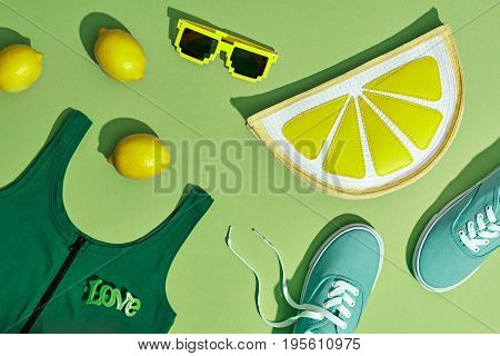 Fashion Summer Hipster Accessories Set. Lemon Citrus fruit, Trendy Sneakers, Cap, fashion Sunglasses on Pink. Hot Summer Sunny Vibes. Creative Bright Style. Vanilla Pastel Color. Minimal, Art