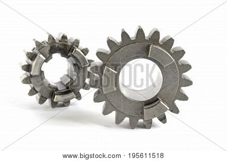 Two metal gears on the white background.