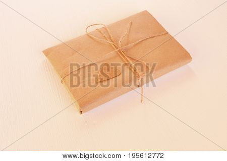 Gift box handicraft wrapping. Gift box photo