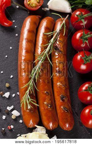 Wiener Sausages On Black Background. Top View.