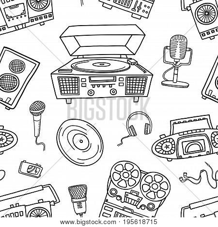 Decorative graphic musical seamless pattern, monochrome endless pattern with tape recorders, microphones, headphones for wallpaper, pattern fills, web page background, textiles.