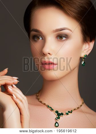 Elegant Fashionable Woman With Jewelry. Beautiful Woman With Emerald Necklace. Young Beauty Model Wi