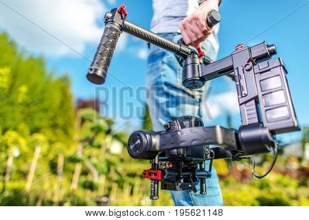 Video Camera Operator. Videography Theme. DSLR Camera on the Gimbal Stabilization Device. Film Production.