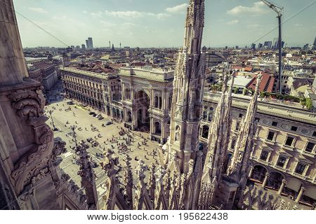 View of Piazza del Duomo with the Galleria Vittorio Emanuele II from the top of the Milan Cathedral (Duomo di Milano) in Milan, Italy. Milan Duomo is the largest church in Italy and the fifth largest in the world.
