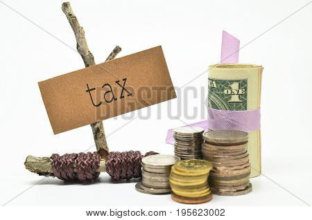 Coins and money with tax label. Financial concept.