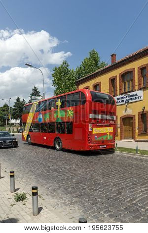 SKOPJE, REPUBLIC OF MACEDONIA - 13 MAY 2017:  A red double-decker bus passing through the streets of city of Skopje, Republic of Macedonia