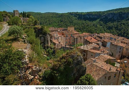 Panoramic view of tower on top of hill with the Châteaudouble village underneath, a quiet and tourist village with medieval origin. Located in the Var department, Provence region, southeastern France