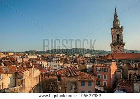 View of the lively and gracious town of Draguignan from the hill of the clock tower, under the colorful light of the sunset. Located in the Var department, Provence region, southeastern France