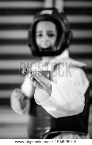 Portrait of tae kwon do girl on training indoors black and white image