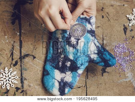 the creation of bright beautiful woolen winter accessories - crafting kraft mittens