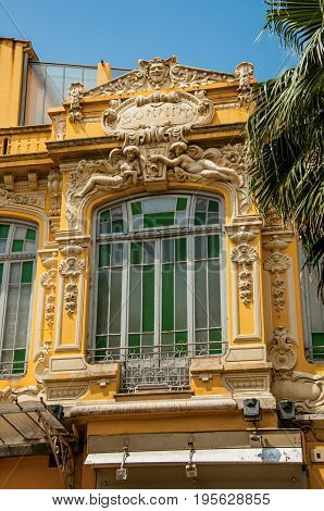 Close-up of all ornate window in a building at the city center of Grasse, a friendly town known for producing perfumes. Located in the Alpes-Maritimes department, Provence region, southeastern France
