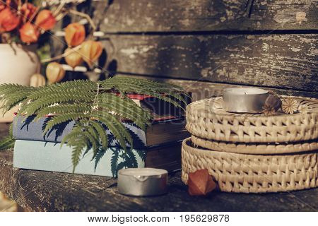 country stillife with book and flowers on a wooden background