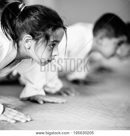 Taekwondo Kids On Training Indoors, Black And White Image